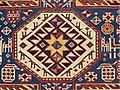 Caucasian Baku Rug Wheel of Life Symbology .jpg