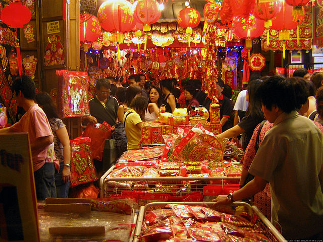 Shoppers at a New Year street market in Chinatown, Singapore. (February 2006)