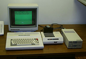 Home computer - Most home computers, such as this Tandy Color Computer 3, featured a version of the BASIC programming language. The sometimes-sprawling nature of the well-outfitted home computer system is very much in evidence.