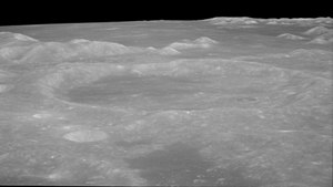 Condorcet (crater) - Oblique view from Apollo 11 facing northwest from about 40 km altitude, with Promontorium Agarum at left and Mare Crisium in background