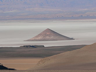 "Geomorphology - ""Cono de Arita"" at the dry lake Salar de Arizaro on the Atacama Plateau, in northwestern Argentina. The cone itself is a volcanic edifice, representing complex interaction of intrusive igneous rocks with the surrounding salt."