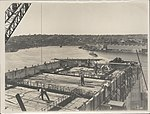 Construction of main platform to the southern approach of the Sydney Harbour Bridge, 1928 (8282706519).jpg