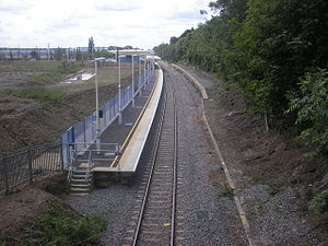 Corby railway station - The new station at Corby, looking south. The platform of the 1987 station can be seen on the right.