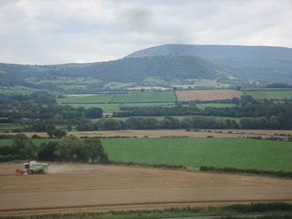 Agriculture in Wales - Corn being combined near Llowes in the Welsh Marches