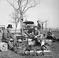 Crews of amphibious DUKW vehicles rest by the roadside east of the Rhine, 25 March 1945. BU2433.jpg