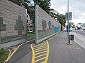 Cycling route, 'Báthory út' bus stop, concrete road noise protection, 2018 Győr.jpg