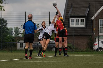 "Ladies' Gaelic football - Ladies' football game beginning with a ""throw-in"" by the referee"