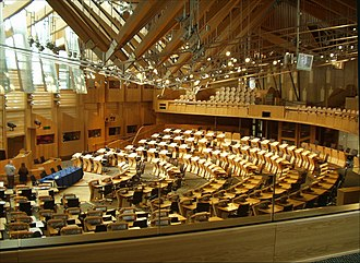 Scottish Parliament - Seating in the debating chamber is arranged in a semicircle, with ministers sitting in the front section of the semicircle, directly opposite the presiding officer and parliamentary clerks.
