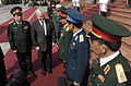 Defense.gov News Photo 101011-F-6655M-015 - Secretary of Defense Robert M. Gates walks with Vietnamese Minister of Defense Gen. Phung Quang Thanh as they greet respective staffs during a.jpg