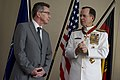 Defense.gov News Photo 110609-N-TT977-358 - Chairman of the Joint Chiefs of Staff Adm. Mike Mullen thanks German Minister of Defense Thomas de Maizière after receiving the German Order of Merit.jpg