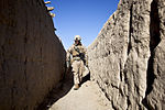 Defense.gov News Photo 120206-M-MM918-004 - U.S. Marine Cpl. Cameron Collier sweeps an alley during a security patrol in the Garmsir district in Afghanistan s Helmand province on Feb. 6.jpg