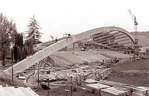 Black and white photograph of a football stand under construction.