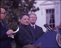 Deng Xiaoping and Jimmy Carter at the arrival ceremony for the Vice Premier of China. - NARA - 183157.tif