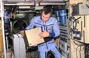 Standard frequency and time signal-satellite service -  GTS-Module onboard ISS, handled by astronaut Vladimir Dezhurov