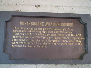 Commemorative plaque - This sign in Dickson, Australian Capital Territory commemorates the establishment of Canberra's first aerodrome and its first fatality in the 1920s.