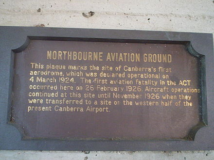 This sign in Dickson, Australian Capital Territory commemorates the establishment of Canberra's first aerodrome and its first fatality in the 1920s. Dickson library plaque ACT.jpg