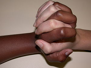 black and white student clasping hands