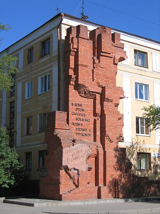 "Pavlov's House - Pavlov's House in its current state. The inscription on the memorial reads: ""In this building fused together heroic feats of warfare and of labor. We will defend / rebuild you, dear Stalingrad!"""