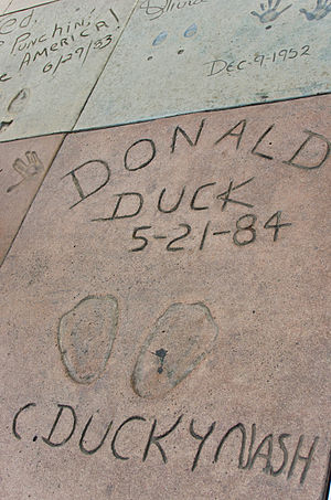 Donald Duck - Donald's footprints at the Grauman's Chinese Theatre in Hollywood. The prints were made during the celebration of Donald's 50th birthday.