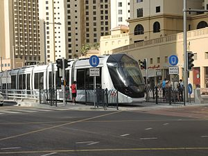 Transportation in Dubai - Tram on test run at stop in Dubai Marina, November 2014