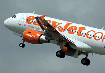 An EasyJet Airbus A319 takes off.