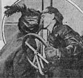 Edna and Silas Christofferson kiss goodbye.jpg