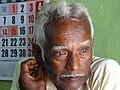 Elderly Man in Shop - Kandy - Sri Lanka (14113007086).jpg