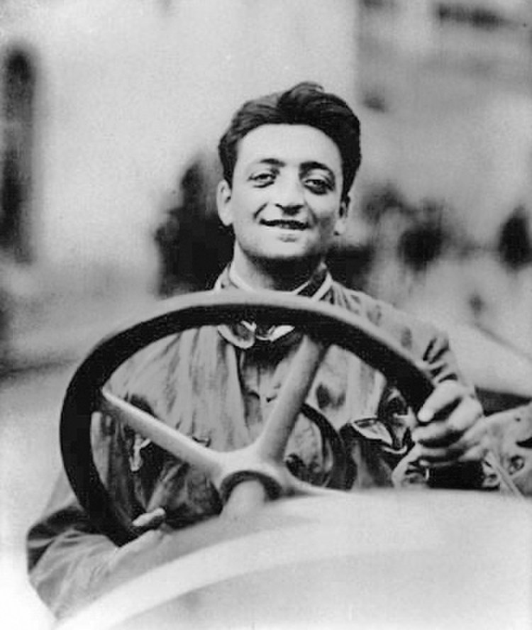 Enzo Ferrari at the wheel of a racing car