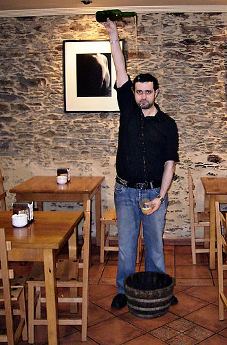 Asturian cuisine - Asturian cider being poured in the traditional manner.