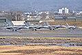 F-15s with a T-4 (-2). Komatsu Air Base (47069241664).jpg
