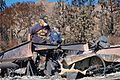 FEMA - 39641 - Voluteers search a burned home site for personal property in Sylmar.jpg