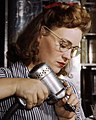 Face detail, Operating a hand drill at North American Aviation, Inc, a woman is working in the control surface department assembling a section of the leading edge for the horizontal stabilizer of a plane, Inglewood, Calif (cropped).jpg