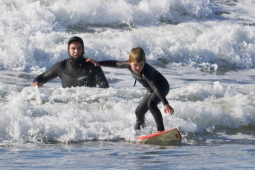 Father and son surf lesson in Morro Bay, CA