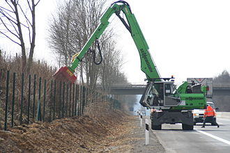 Forestry mulching - Fecon mulching attachment on a Sennebogen excavator, being used to clear roadside brush in Germany