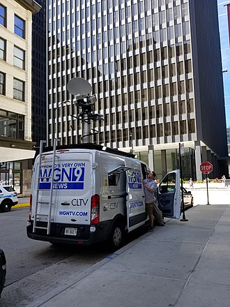 WGN-TV - News van outside the Dirksen Federal Building in June 2018