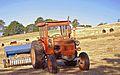 Fiat tractor baling hay in Australia.jpg