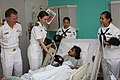 Flickr - Official U.S. Navy Imagery - Sailors give ballcaps at a children's hospital..jpg