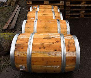 Four wet wooden barrels.jpg