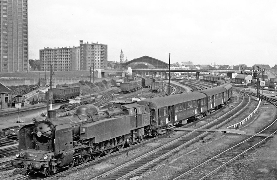 Approaches to Lille Fives (Nord) 1957, with a 242.TA class 4-8-4T propelling coaches into the station.