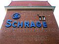 Friedrich Schrage GmbH Logo über verwittertem Schriftzug neben der Einfahrt Badenstedter Straße 98 A B, 30453 Hannover Körtingsdorf.jpg