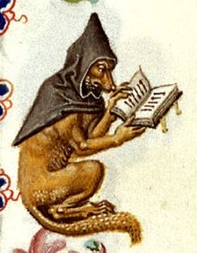 A fox wearing a monk's cowl and looking at a book