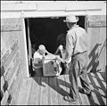 Gila River Relocation Center, Rivers, Arizona. Loading crates on truck to be shipped to their forme . . . - NARA - 539839.jpg