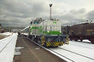 VR Group - A modernised and recoloured diesel locomotive pulls a regional train to Varkaus railway station in 2011.