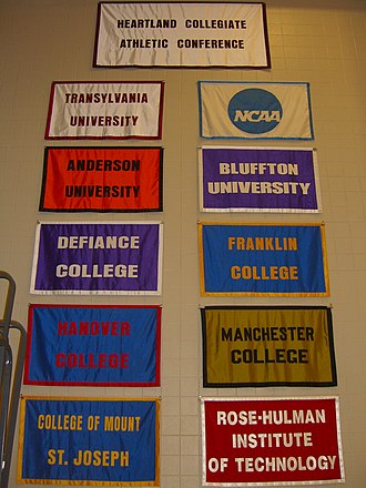"Heartland Collegiate Athletic Conference - HCAC school banners hang at the Clive M. Beck Athletic and Recreation Center at Transylvania University. This picture was taken in 2009, before Earlham's arrival in the conference and Mount St. Joseph's designation as a ""University""."