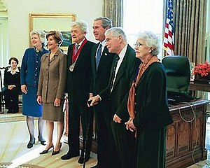 Hal Holbrook - President George W. Bush and Laura Bush pose for a photo with Holbrook (center), a recipient of the National Humanities Medal in the Oval Office on November 14, 2003