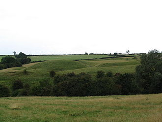 Castles in Great Britain and Ireland - Hallaton Castle in England, showing a well preserved post-invasion earth motte (l) and bailey (r)