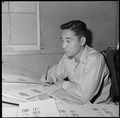 Heart Mountain Relocation Center, Heart Mountain, Wyoming. A young poster artist at work in the pos . . . - NARA - 539269.tif