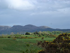 Carrowmore - View from Carrowmore of Ballygawley Hills to S/E, with a megalithic tomb on top of each.