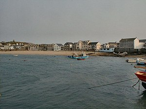 Hugh Town - View of the town from the quay, with Town Beach running between the harbour and the rear of buildings