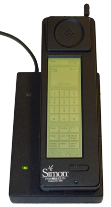 Photograph of the Simon Personal Communicator shown in its charging base